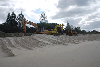 3 pieces of beach scraping machinery.